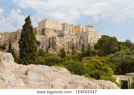 The Acropolis of Athens Greece viewed from a rocky hill across the Acropolis rock