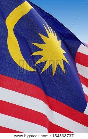 Malaysian flag blowing wind. Close-up. Outdoor shot, postproduction.