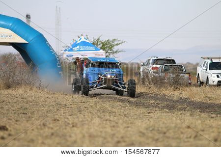 Speeding Blue Zarco Rally Car At Start Of Race