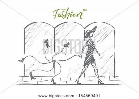 Vector hand drawn Fashion time concept sketch. Stylish woman in dress and hat walking alone and carrying bunch of new footwear tied with rope. Lettering Fashion time