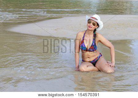 Women body pretty bikini hat and sunglasses on Thung Wua Lan Beach at Chumphon Provice Thailand.