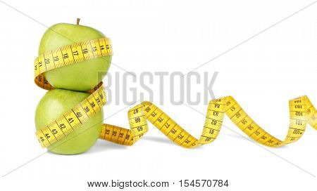 Fresh apples with measuring tape on white background