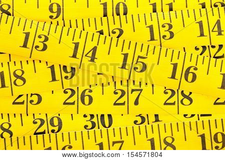 Frame filling yellow measurement tape background texture