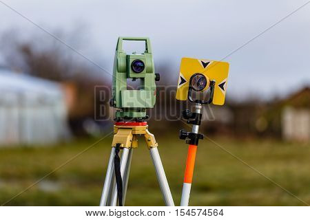 Surveying equipment: total station and geodesic landmark.