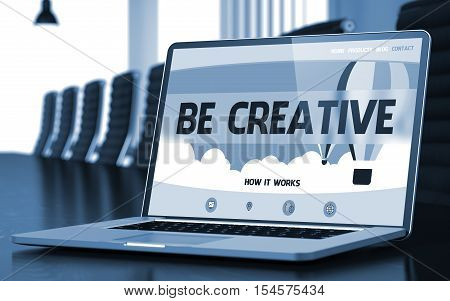 Modern Meeting Room with Laptop on Foreground Showing Landing Page with Text Be Creative. Closeup View. Blurred Image. Selective focus. 3D.