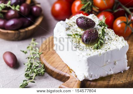 Greek cheese feta with thyme and olives selective focus