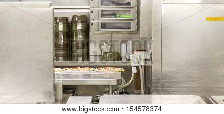Pizza Prep Area in Commercial Kitchen on stainless steel
