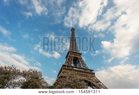 Perspective View of The Eiffel Tower in Paris against blue sky with clouds, France