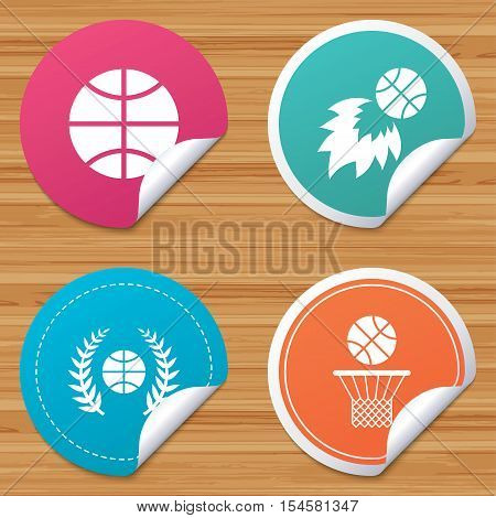 Round stickers or website banners. Basketball sport icons. Ball with basket and fireball signs. Laurel wreath symbol. Circle badges with bended corner. Vector