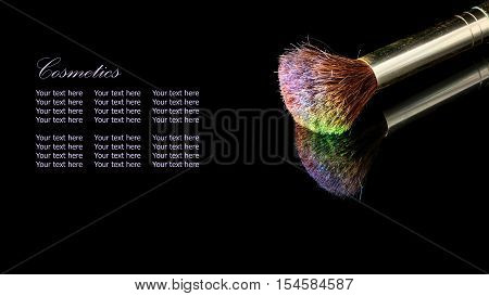 Makeup Brush On Professional Cosmetic Isolated On Black Background With Reflexion.
