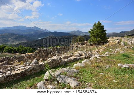 View on the archaeological sites of Mycenae and Tiryns on a beautiful rural greek landscape mountain and agricultural fields