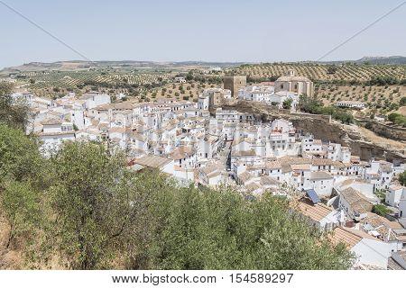 Setenil de las Bodegas Cadiz Spain. Street with dwellings built into rock overhangs above Rio Trejo.