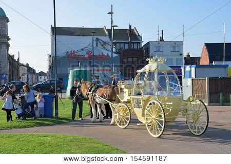Great Yarmouth Norfolk United Kingdom - October 25 2016: Cinderella carriage ride by Great Yarmouth seafront