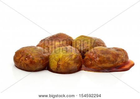 some peeled prickly pear fruits in their own juice, on a white background