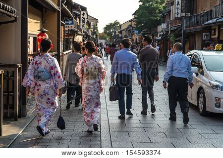 Kyoto Japan - October 22 2015: Three women in traditional Kimono clothing in the Gion District.