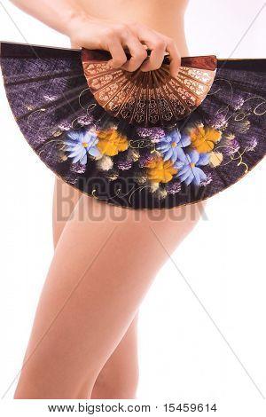 woman with fan in hand