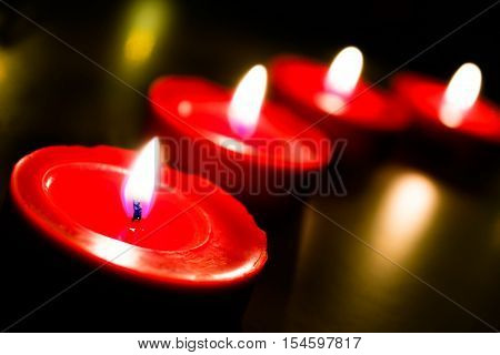 Decoration with four red candles and background