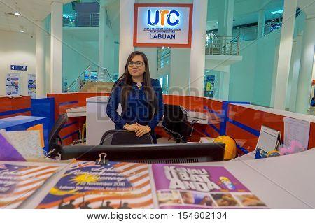Labuan,Malaysia-Nov 2,2016:Happy receptionist in Labuan UTC at Labuan,Malaysia.Urban Transformation Centre (UTC) launched by Prime Minister of Malaysia Datuk Seri Najib Tun Razak on 6th Febuary 2016.
