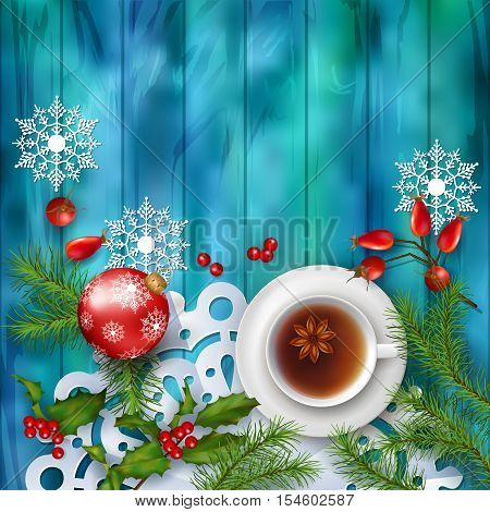 Christmas tea party background. Holiday top view background with cup of tea tree branches Rosehip berries ornament and star anise on wooden table