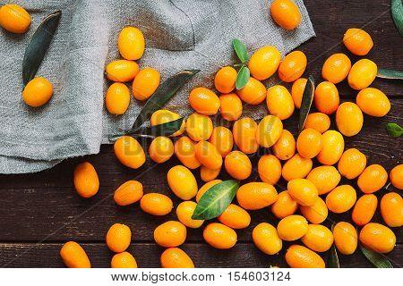Kumquats on Dark Wooden Background, Top View, Vintage Filter