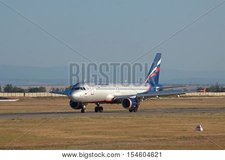 Simferopol Ukraine - September 12 2010: Aeroflot Airbus A320 reversing the engines on the runway after landing
