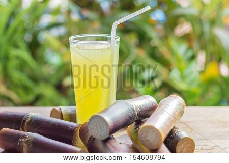 Sugarcane Fresh Juice For A Detox Diet - Organic Fruits On Wooden Background. Closeup Image / Select
