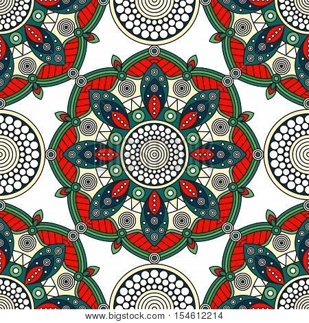 Seamless ethnic mandala pattern. Decorative ornamental print with Oriental art motifs in traditional Christmas palette of bright greens, red, white & pastel yellow.