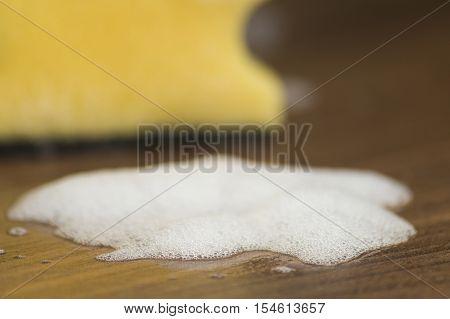 Yellow Sponge on the kitchen tray. Sponges. Kitchen work,