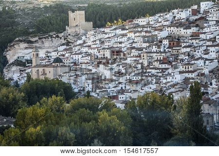Alcala del Jucar Spain - October 29 2016: Panoramic view of the city on top of limestone mountain is situated Castle of the 12TH century Almohad origin take in Alcala of the Jucar Albacete province Spain
