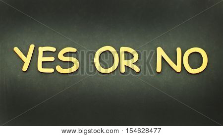 Words yes or no made with block wooden letters on background