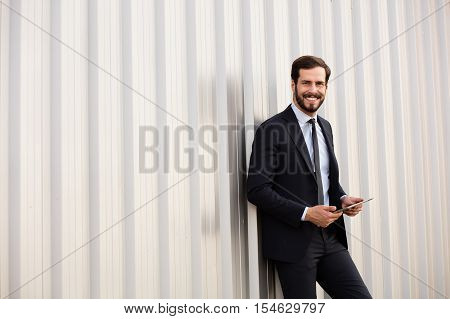 Happy Elegant Man With A Tablet In Hands