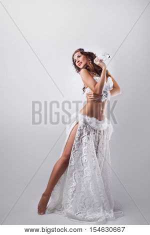 Women in carnival white dresses.Full length portrait of beautiful girl in studio against gray background
