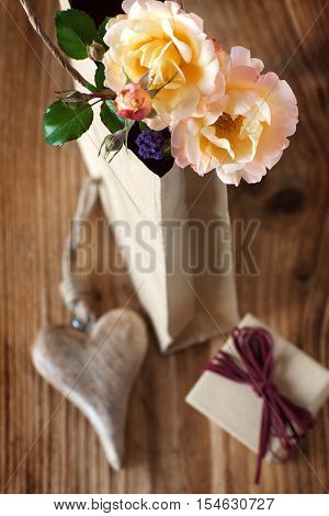 Still life with a cordially gift on a wooden table for mother's day