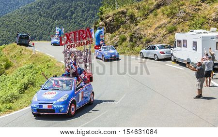 Col D'AspinFrance- July 152015: X-tra Total Caravan during the passing of the Publicity Caravan on the Col d'Aspin in Pyerenees Mountains in the stage 11 of Le Tour de France 2015.X-tra Total is a good detergent for all fabrics produced by Henkel.