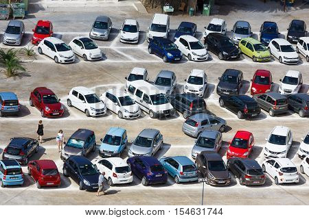 Vai Beach, Greece - October 13, 2016: A lot of cars in the parking lot near the famous Vai beach in autumn time