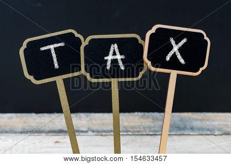 Word Tax Written With Chalk On Wooden Mini Blackboard Labels