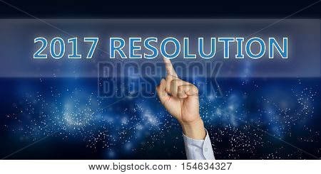 Photo image of male hand clicking New Year 2017 Resolution on virtual cyber space
