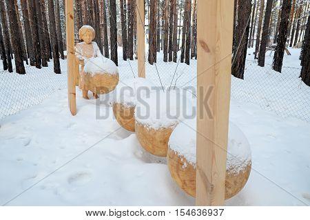 Irkutsk Region,ru-jan, 03 2015: The Composition Of Perpetuum Mobile. Park Of Wooden Sculptures In Sa