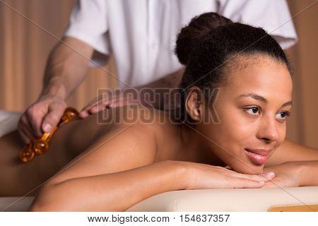 Afroamerican Woman Having Back Massage