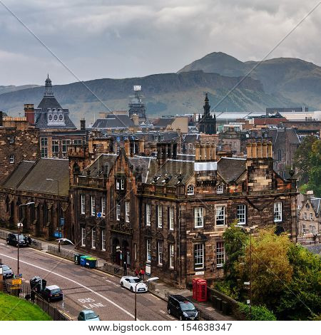Aerial view of historical part in Edinburgh, Scotland. Arthur's Seat mountain at the background