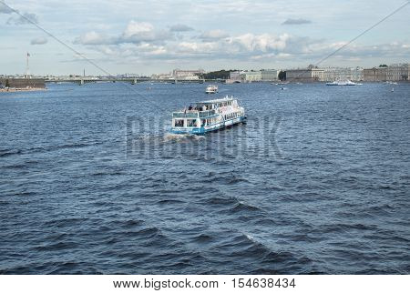 Saint Petersburg Russia September 10 2016: Excursion boat with tourists floats on the Neva river in St. Petersburg Russia.