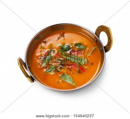 Vegan and vegetarian dish, spicy creamy tomato dahl soup bowl. Indian cuisine, masala hot meal isolated on white background. Eastern local cuisine restaurant food top view