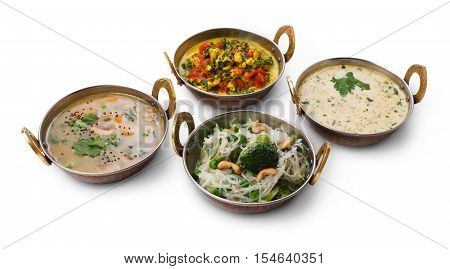 Vegan and vegetarian restaurant dishes, hot spicy and creamy indian soups and rice vermicelli in copper bowls. Traditional indian cuisine meals isolated on white background. Healthy eastern local food