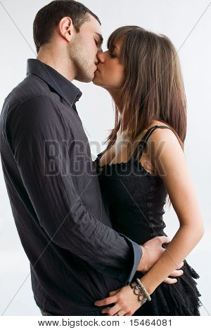 young couple kissing, studio shot