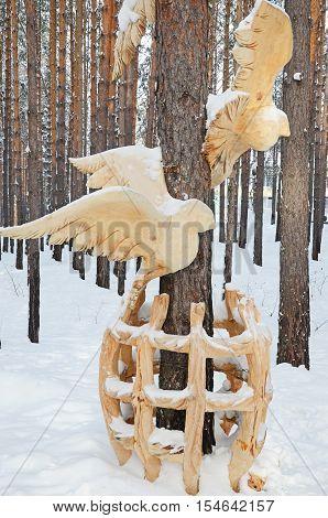 Irkutsk Region,russia-jan, 03 2015: Birds Out Of Cage. Park Of Wooden Sculptures In Savvateevka Vill
