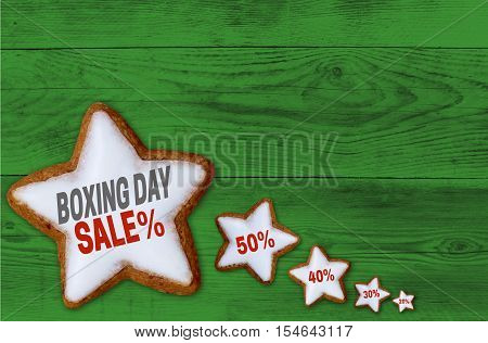 Boxing Day Sale Cinnamon Star On Green Wood Concept