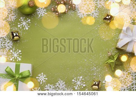 Christmas gift boxes and balls on festive background