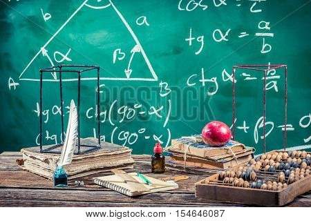 Lecture of trigonometry in school on old wooden table