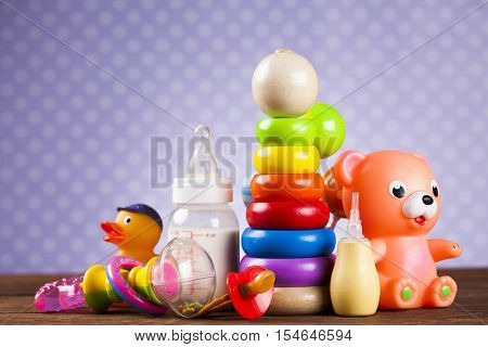Baby World toy collection on on wooden background