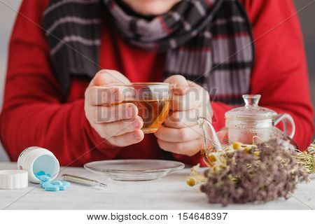 Male With Rheum Holding A Cup Of Hot Tea